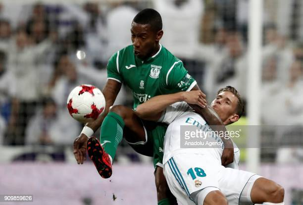 Marcos Llorente of Real Madrid in action against Claudio Beauvue of Leganes during the Copa del Rey quarter final match between Real Madrid and...