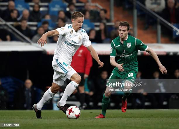 Marcos Llorente of Real Madrid in action against Javi Eraso of Leganes during the Copa del Rey quarter final match between Real Madrid and Leganes at...