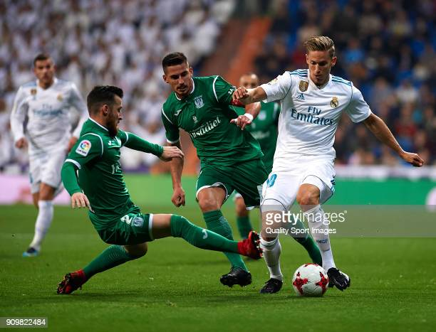 Marcos Llorente of Real Madrid is tackled by Tito of Leganes during the Spanish Copa del Rey Quarter Final Second Leg match between Real Madrid and...