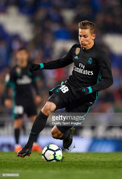 Marcos Llorente of Real Madrid runs with the ball during the La Liga match between Espanyol and Real Madrid at Estadio de CornellaEl Prat on February...
