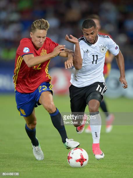 Marcos Llorente of Spain holds off Serge Gnabry of Germany during the UEFA European Under21 Championship Final between Germany and Spain at Krakow...