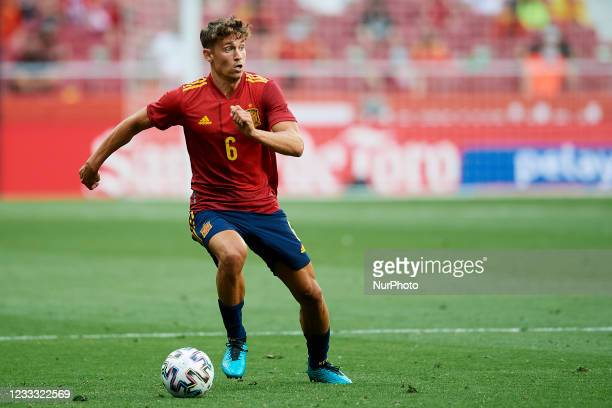 Marcos Llorente of Spain runs with the ball during the international friendly match between Spain and Portugal at Estadio Wanda Metropolitano on June...