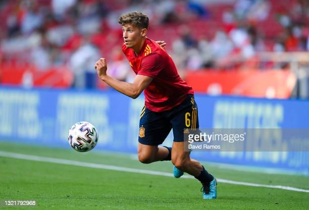 Marcos Llorente of Spain runs with the ball during the international friendly match between Spain and Portugal at Wanda Metropolitano stadium on June...