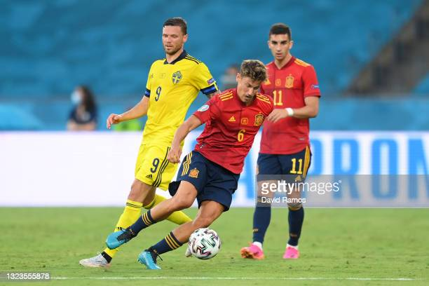 Marcos Llorente of Spain runs with the ball whilst under pressure from Marcus Berg of Sweden during the UEFA Euro 2020 Championship Group E match...