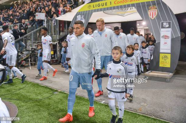 Marcos Lopes and Kamil Glik of Monaco during the Ligue 1 match between Amiens SC and AS Monaco at Stade de la Licorne on November 17 2017 in Amiens