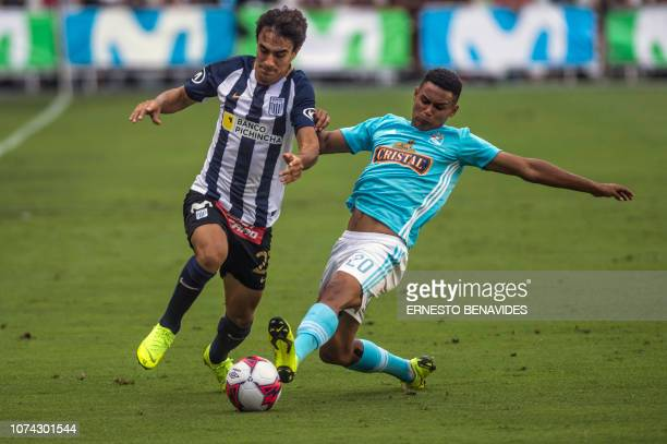 Marcos Lopez from Sporting Cristal vies for the ball with Luis Garro from Alianza Lima during the Descentralizado Tournament football final at the...