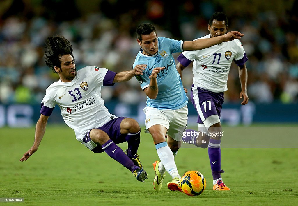 Marcos Lopez of Manchester City evades a tackled by Hussain Abdulrahman of l Ain during the friendly match between Al Ain and Manchester City at Hazza bin Zayed Stadium on May 15, 2014 in Al Ain, United Arab Emirates.