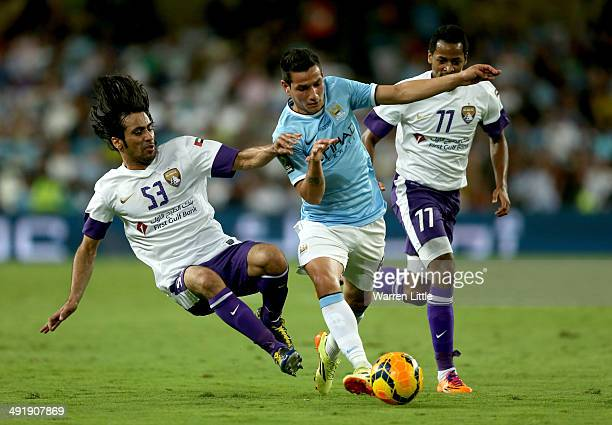 Marcos Lopez of Manchester City evades a tackled by Hussain Abdulrahman of l Ain during the friendly match between Al Ain and Manchester City at...