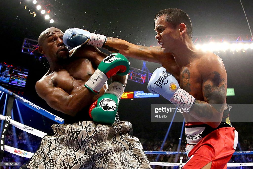 Marcos Maidana throws a right to the face of Floyd Mayweather Jr. during their WBC/WBA welterweight title fight at the MGM Grand Garden Arena on September 13, 2014 in Las Vegas, Nevada.