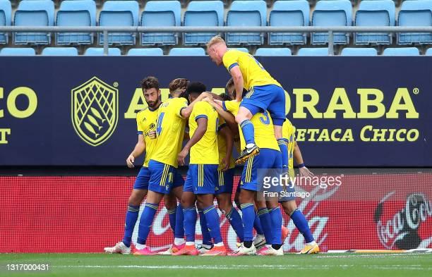 Marcos Mauro of Cadiz CF celebrates scoring a goal with team mates during the La Liga Santander match between Cadiz CF and SD Huesca at Estadio Ramon...
