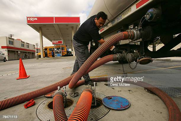 Marcos Moran delivers gasoline to an Exxon gas station on February 1 2008 in Burbank California Exxon Mobil Corp has posted an annual profit of $406...