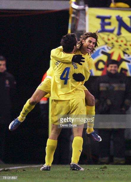 Marcos of Villarreal celebrates with Jose Enrique after scoring a goal against Real Madrid is tackled by during the La Liga match between Villarreal...