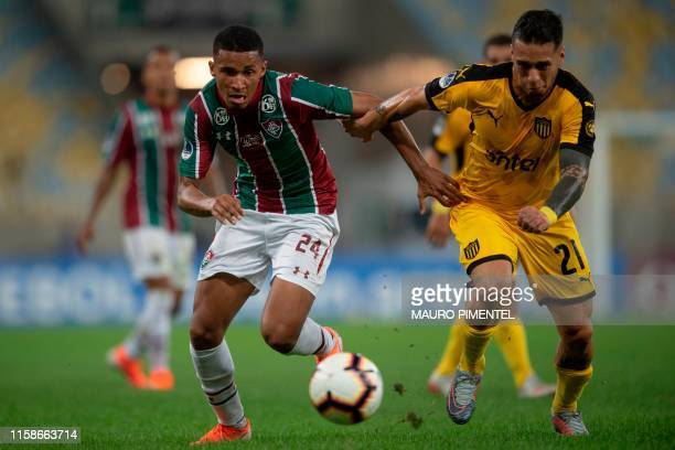 Marcos Paulo of Brazil's Fluminense vies for the ball with Jesus Trindade of Uruguay's Penarol during their Copa Sudamericana football match at...
