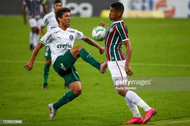Marcos Paulo of Fluminense fights for the ball against Marcos Rocha of Palmeiras during the match between Fluminense and Palmeiras as part of 2020...