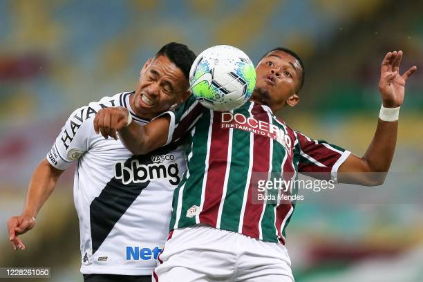 Marcos Paulo of Fluminense struggles for the ball with Yago Pikachu of Vasco da Gama during a match between Fluminense and Vasco da Gama as part of...