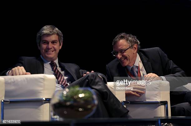 Marcos Pena chief of the Cabinet of Ministers of Argentina and Claudio Cesario president of the Argentine Bankers Association smile during the 50th...
