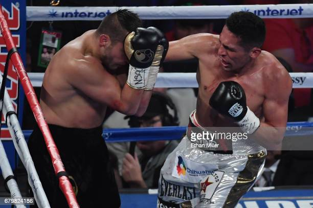 Marcos Reyes punches David Lemieux during their middleweight bout at TMobile Arena on May 6 2017 in Las Vegas Nevada Lemieux won by unanimous decision