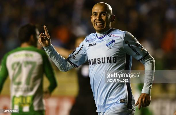 Marcos Riquelme of Bolivia's Bolivar celebrates after scoring against Atletico Nacional of Colombia during their Copa Libertadores football match at...