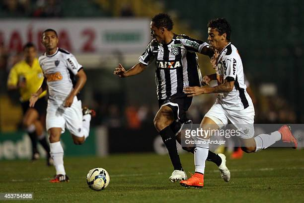 Marcos Rocha of Atletico MG try to stop Marcao of Figueirense during a match between Figueirense and Atletico MG as part of Campeonato Brasileiro...