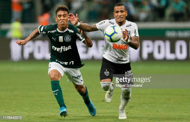 Marcos Rocha of Palmeias vies the ball with Otero of Atletico MG during a match between Palmeiras and Atletico MG for the Brasileirao Series A 2019...