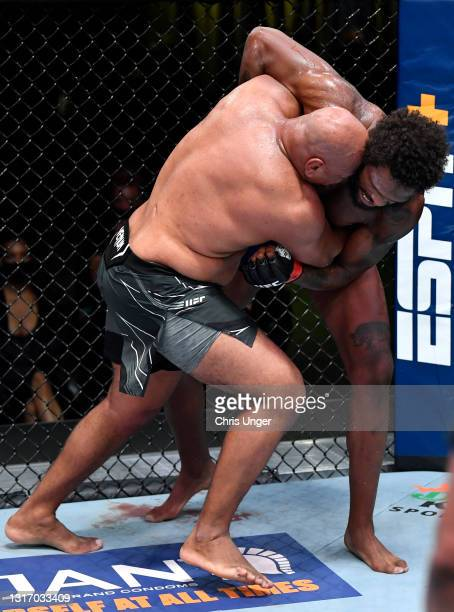 Marcos Rogerio de Lima of Brazil attempts to take down Maurice Greene in a heavyweight fight during the UFC Fight Night event at UFC APEX on May 08,...