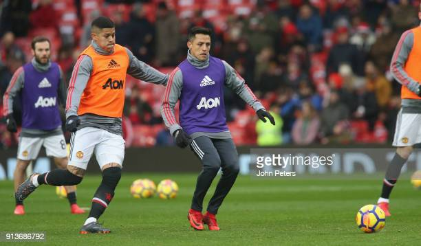 Marcos Rojo and Alexis Sanchez of Manchester United warm up ahead of the Premier League match between Manchester United and Huddersfield Town at Old...