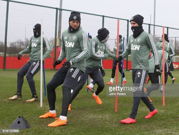 Marcos Rojo and Juan Mata of Manchester United in action during a first team training session at Aon Training Complex on February 14 2018 in...