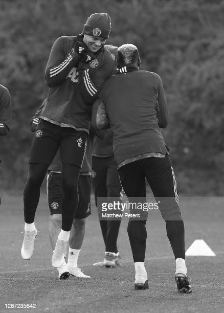 Marcos Rojo and Paul Pogba of Manchester United in action during a first team training session ahead of the UEFA Champions League Group H stage match...