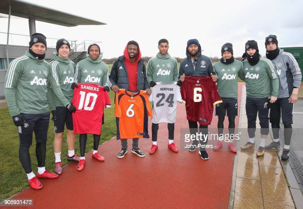 Marcos Rojo Ander Herrera Ashley Young Marcus Rashford Jesse Lingard Luke Shaw and Nemanja Matic of Manchester United pose with NFL stars Josh Norman...