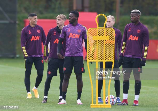 Marcos Rojo Brandon Williams Axel Tuanzebe Donny van de Beek Paul Pogba of Manchester United in action during a first team training session ahead of...