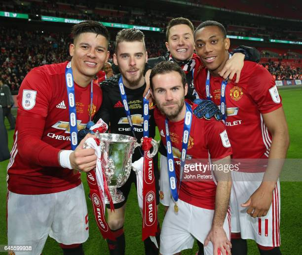 Marcos Rojo David de Gea Juan Mata Ander Herrera and Anthony Martial of Manchester United celebrate after the EFL Cup Final match between Manchester...