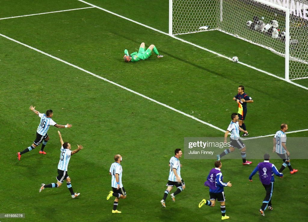Marcos Rojo, Martin Demichelis, Pablo Zabaleta, Lionel Messi, Sergio Aguero and Rodrigo Palacio of Argentina celebrate defeating the Netherlands in a penalty shootout as goalkeeper Jasper Cillessen of the Netherlands reacts during the 2014 FIFA World Cup Brazil Semi Final match between the Netherlands and Argentina at Arena de Sao Paulo on July 9, 2014 in Sao Paulo, Brazil.