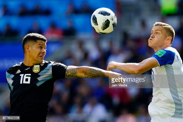 Marcos Rojo of Argentina and Alfred Finnbogason of Iceland fight for the ball during the 2018 FIFA World Cup Russia group D match between Argentina...