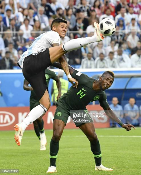 Marcos Rojo of Argentina and Kelechi Iheanacho of Nigeria compete for the ball during a World Cup Group D match in St Petersburg Russia on June 26...