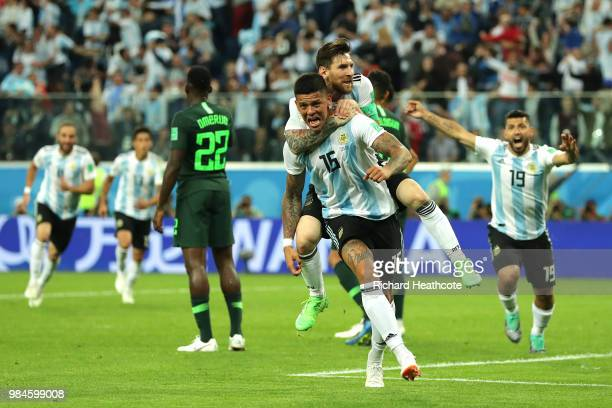 Marcos Rojo of Argentina celebrates after scoring his team's second goal with teammate Lionel Messi during the 2018 FIFA World Cup Russia group D...
