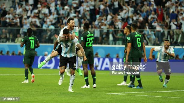 Marcos Rojo of Argentina celebrates after scoring his team's second goal with teammate Lionel Messi as Victor Moses Kenneth Omeruo and Leon Balogun...