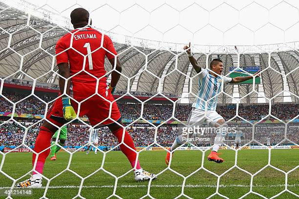 Marcos Rojo of Argentina celebrates after scoring his team's third goal past Vincent Enyeama of Nigeria during the 2014 FIFA World Cup Brazil Group F...