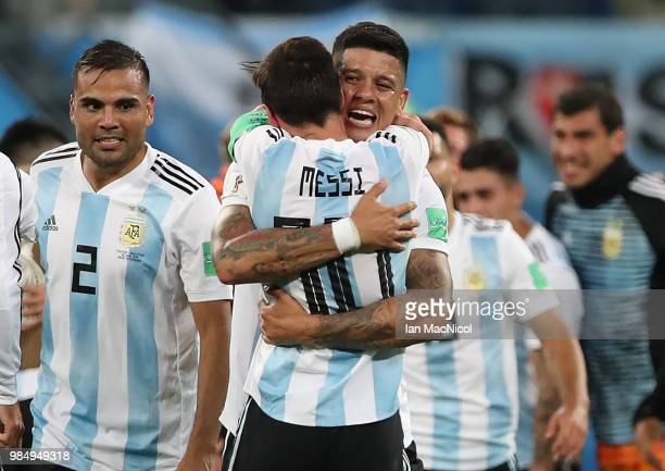 Marcos Rojo of Argentina celebrates at full time with Lionel Messi during the 2018 FIFA World Cup Russia group D match between Nigeria and Argentina...
