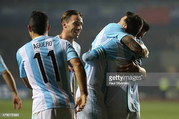 Marcos Rojo of Argentina celebrates hugs teammate Lionel Messi after scoring the opening goal during the 2015 Copa America Chile Semi Final match...
