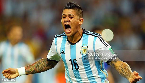 Marcos Rojo of Argentina celebrates their team's first goal during the 2014 FIFA World Cup Brazil Group F match between Argentina and...