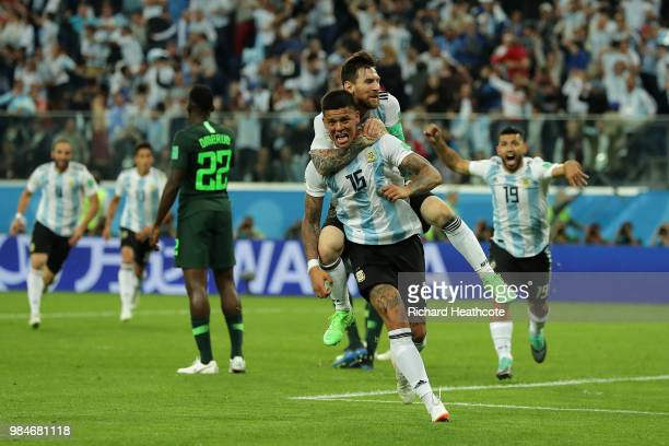 Marcos Rojo of Argentina celebrates with teammate Lionel Messi after scoring his team's second goal during the 2018 FIFA World Cup Russia group D...