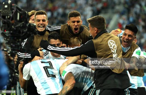 Marcos Rojo of Argentina celebrates with teammates after scoring his team's second goal during the 2018 FIFA World Cup Russia group D match between...