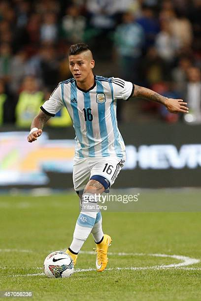 Marcos Rojo of Argentina drives the ball during a match between Argentina and Brazil as part of 2014 Superclasico de las Americas at Bird Nest...