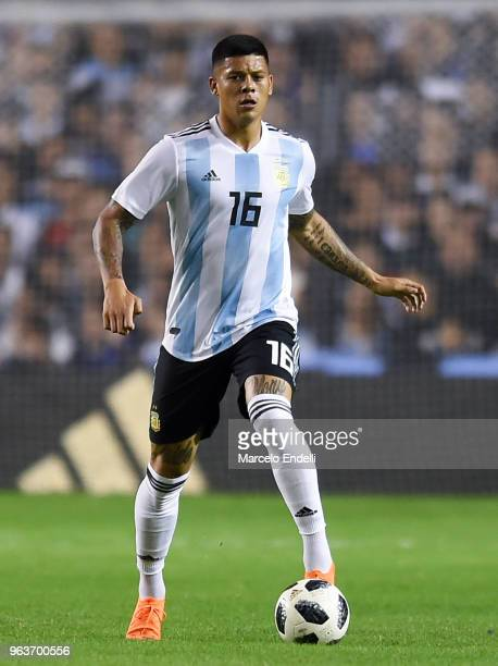 Marcos Rojo of Argentina drives the ball during an international friendly match between Argentina and Haiti at Alberto J Armando Stadium on May 29...