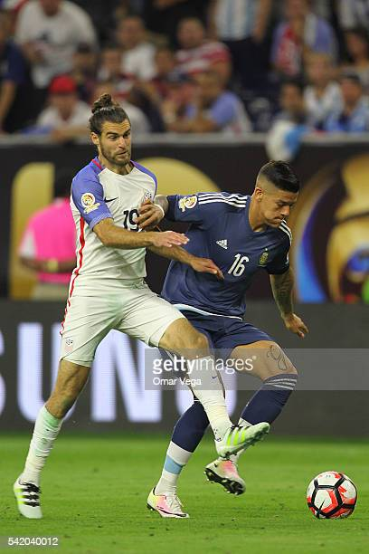 Marcos Rojo of Argentina fights for the ball with Graham Zusi of United States during the Semifinal match between United States and Argentina at NRG...