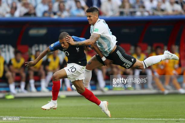 Marcos Rojo of Argentina fouls Kylian Mbappe of France to concede a penalty during the 2018 FIFA World Cup Russia Round of 16 match between France...