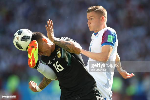 Marcos Rojo of Argentina vies with Alfred Finnbogason of Iceland during the 2018 FIFA World Cup Russia group D match between Argentina and Iceland at...