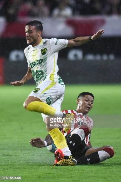 Marcos Rojo of Estudiantes tackles Francisco Pizzini of Defensa y Justicia during a match between Estudiantes and Defensa y Justicia as part of...
