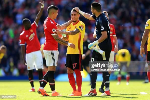 Marcos Rojo of Man Utd and Man Utd goalkeeper Sergio Romero greet fellow Argentinian Roberto Pereyra of Watford after the Premier League match...