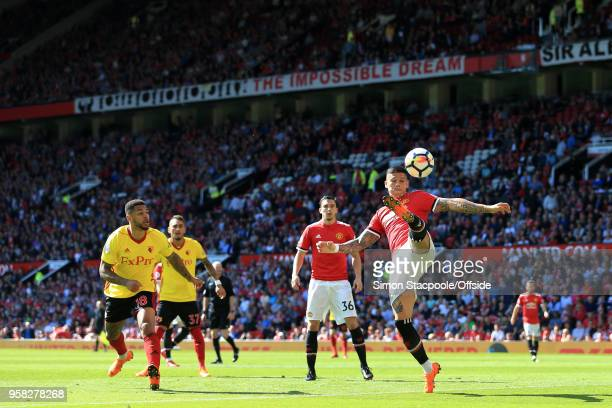 Marcos Rojo of Man Utd clears the ball during the Premier League match between Manchester United and Watford at Old Trafford on May 13 2018 in...
